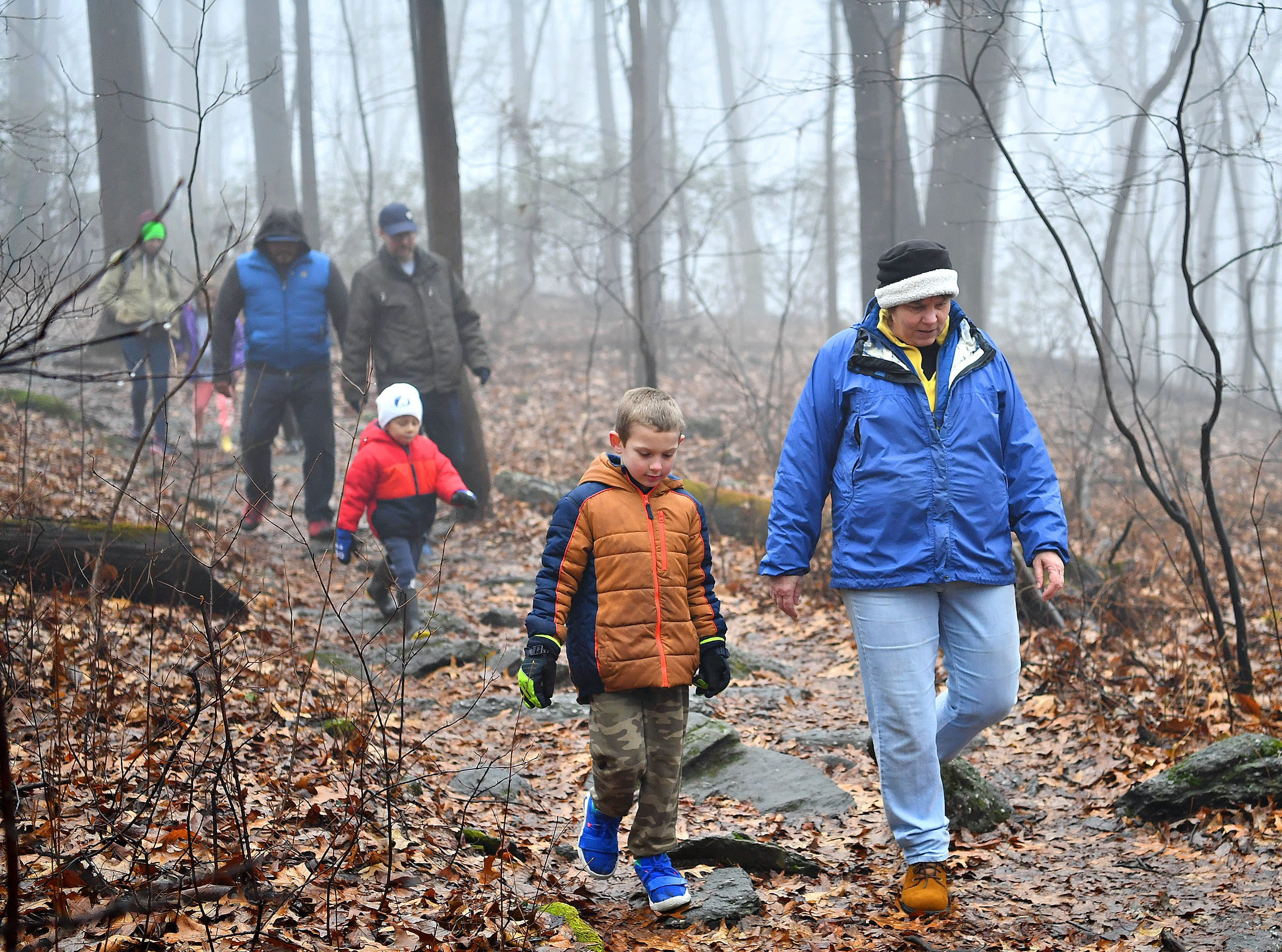Tanya Merchant, right, of East Manchester Township, walks with neighbor Lucas Buckler, 6, during a Marshmallow Hike led by York County Parks Naturalist Kelsey Frey at Rocky Ridge Park in Springettsbury Township, Friday, Dec. 28, 2018. Dawn J. Sagert photo