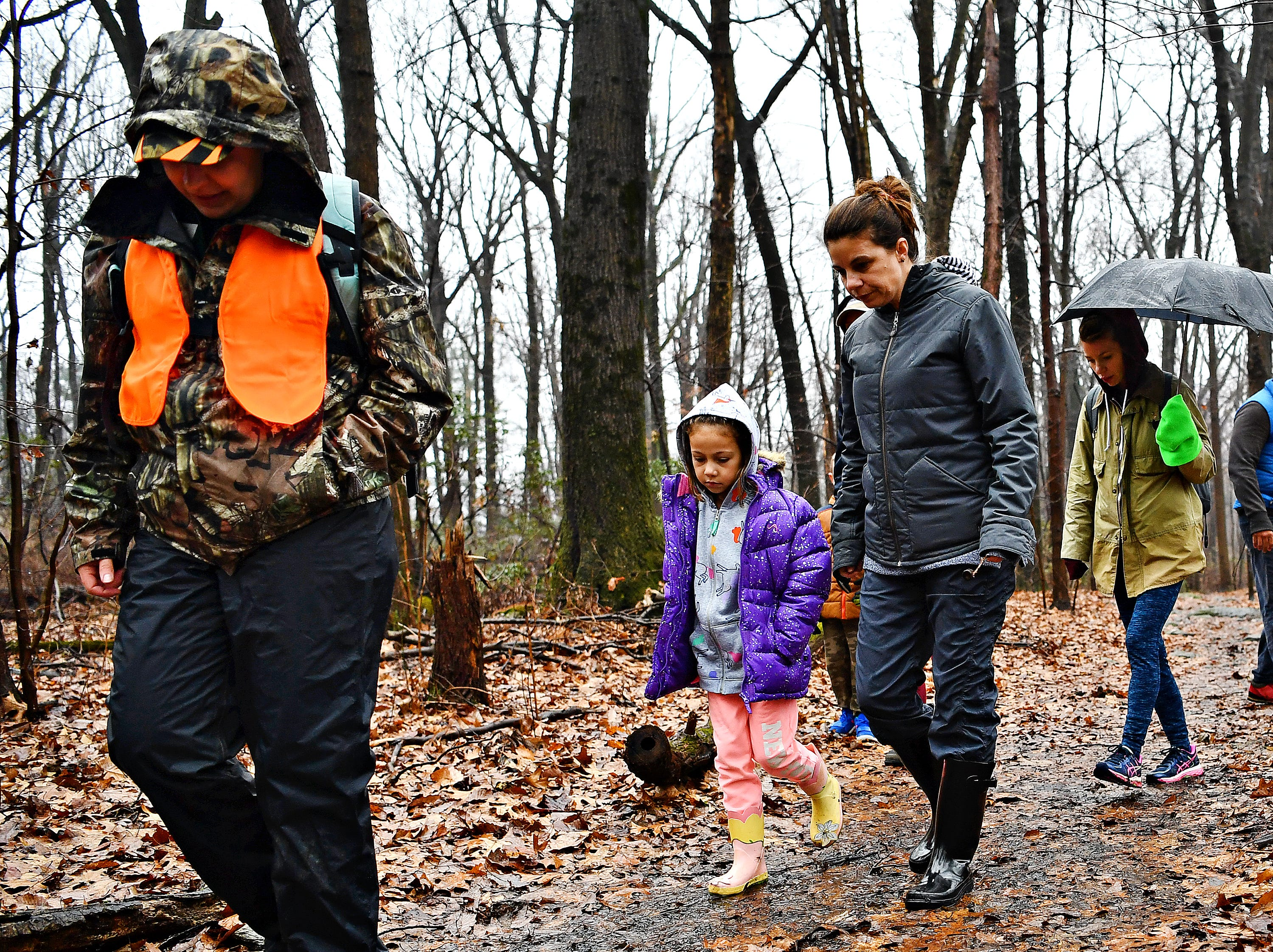 From left, York County Parks Naturalist Kelsey Frey leads Matilda Hernandez, 7, and her mother Tiffany Butler, both of Yucatan, Mexico, and Melanie Butler, of Lancaster, during a Marshmallow Hike at Rocky Ridge Park in Springettsbury Township, Friday, Dec. 28, 2018. Dawn J. Sagert photo