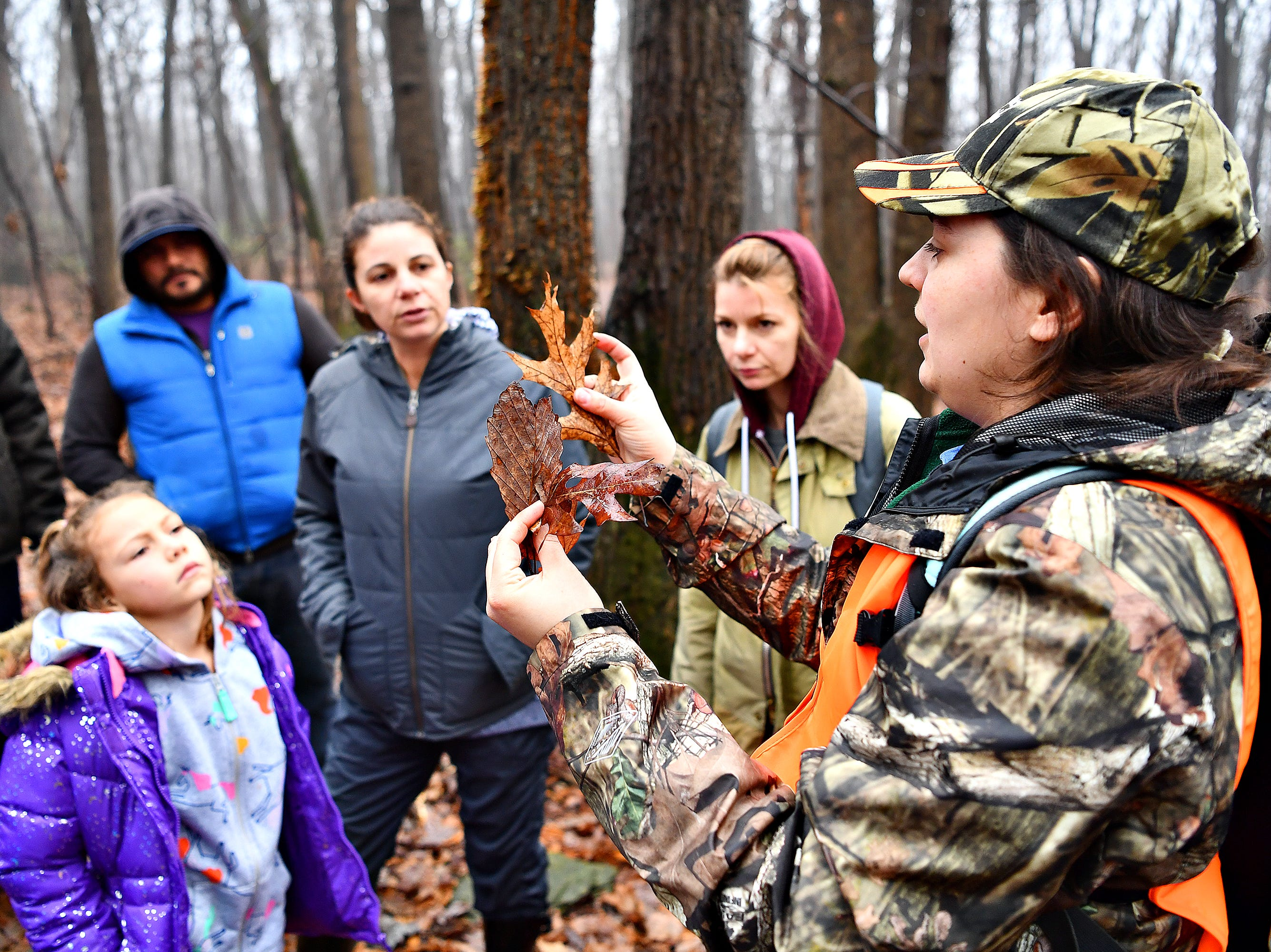 York County Parks Naturalist Kelsey Frey discusses different varieties of leaves during a Marshmallow Hike at Rocky Ridge Park in Springettsbury Township, Friday, Dec. 28, 2018. Dawn J. Sagert photo