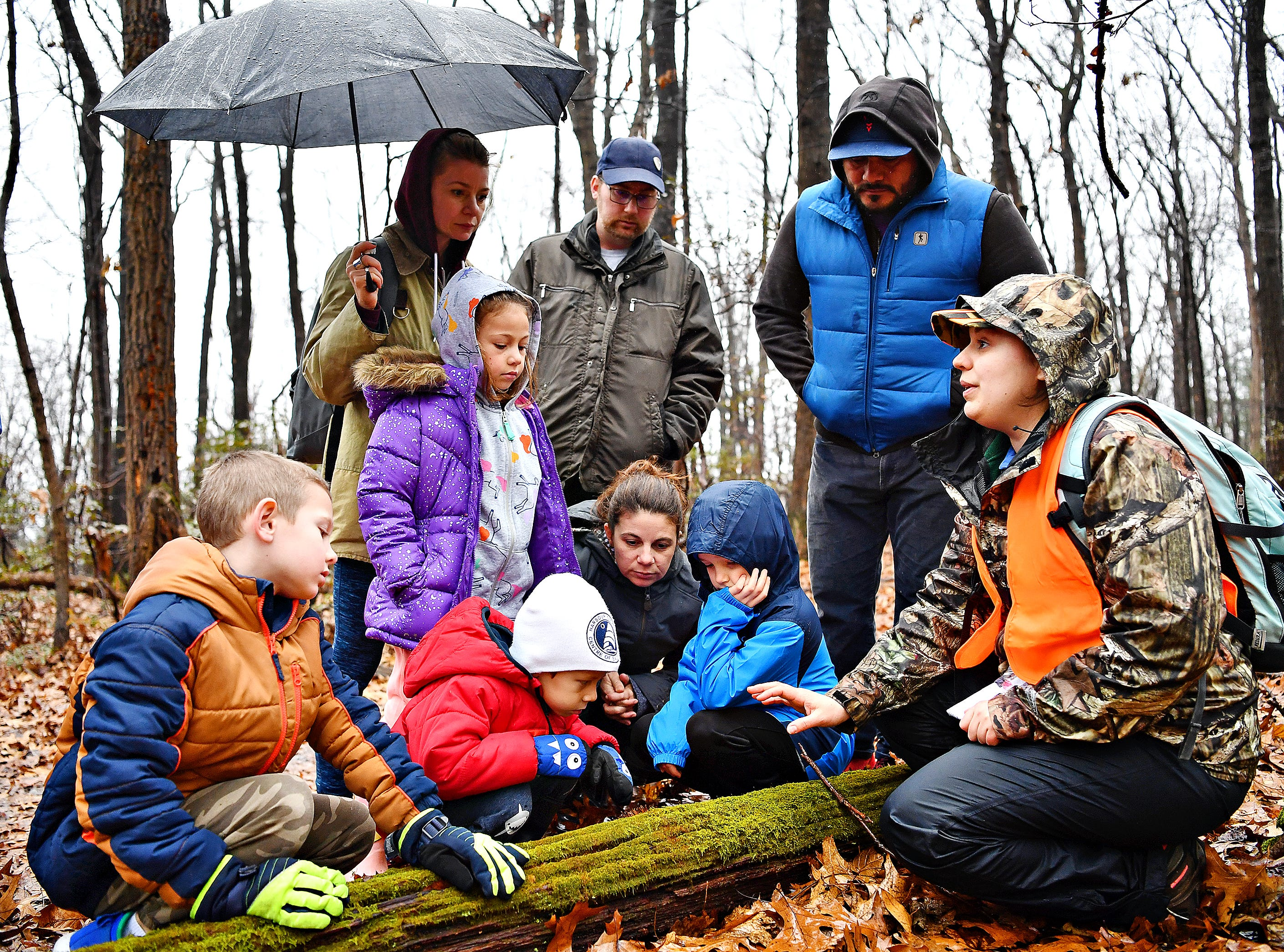 York County Parks Naturalist Kelsey Frey, front right, talks about moss during a Marshmallow Hike at Rocky Ridge Park in Springettsbury Township, Friday, Dec. 28, 2018. Hikers would enjoy a hot cup of cocoa with marshmallows following the hike. Dawn J. Sagert photo
