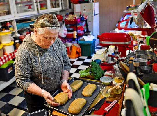 Owner Deb Volker, of Nana's Oven, shapes vegan loaves of multigrain, multiseeded bread at Penn Market in York City, Friday, Dec. 28, 2018. Nana's Oven has been in Penn Market since March of 2016. Dawn J. Sagert photo