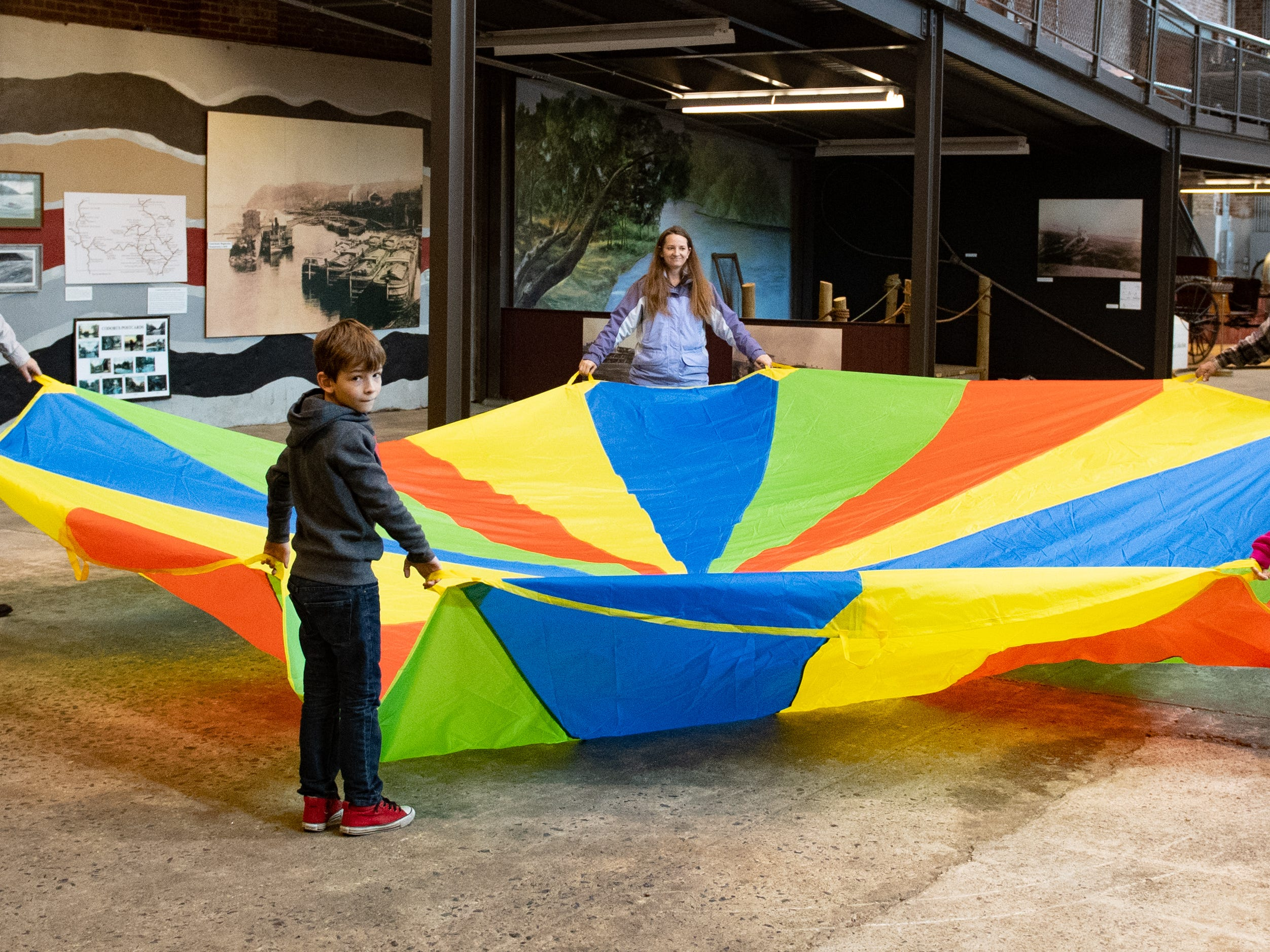 Family Activity Day featured two parachutes that allowed kids to bounce small balls high into the air among other things, December 28, 2018.