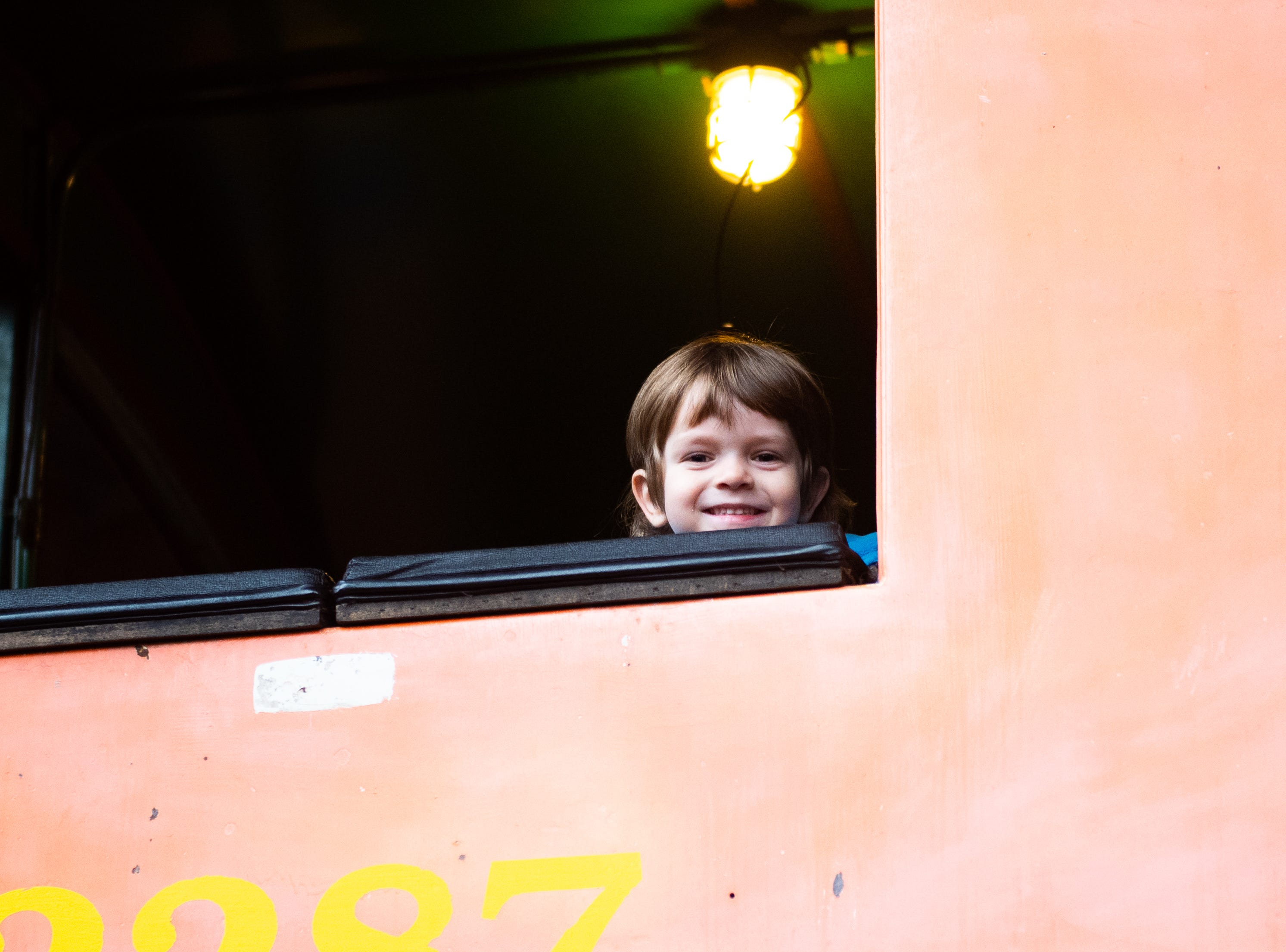 Garon Erdenbrack, 4, of Springettsbury Township pokes his head out of a life sized train, his favorite exhibit, December 28, 2018.