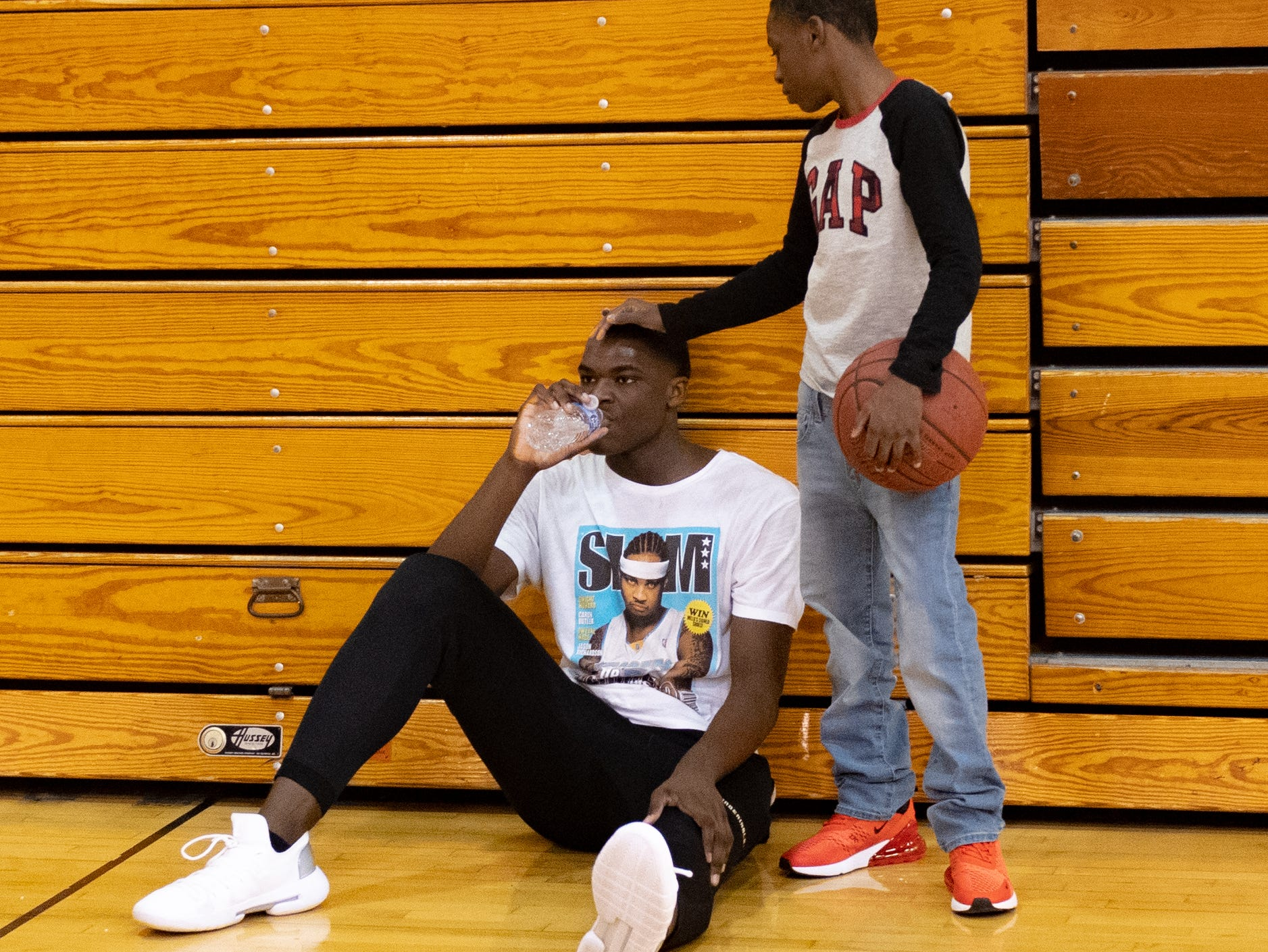 Jarace Walker (left) and Marcellus Dobbins (right) take a quick water break during the workout at Susquehannock High School, December 27, 2018.