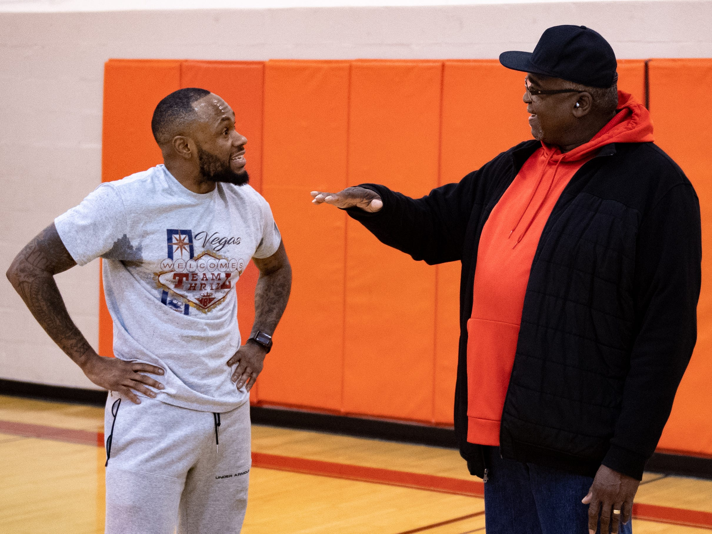 Jarace Walker's father, Horace (right), talks to Mookie Dobbins (left) about how much his son has grown over the years, December 27, 2018.