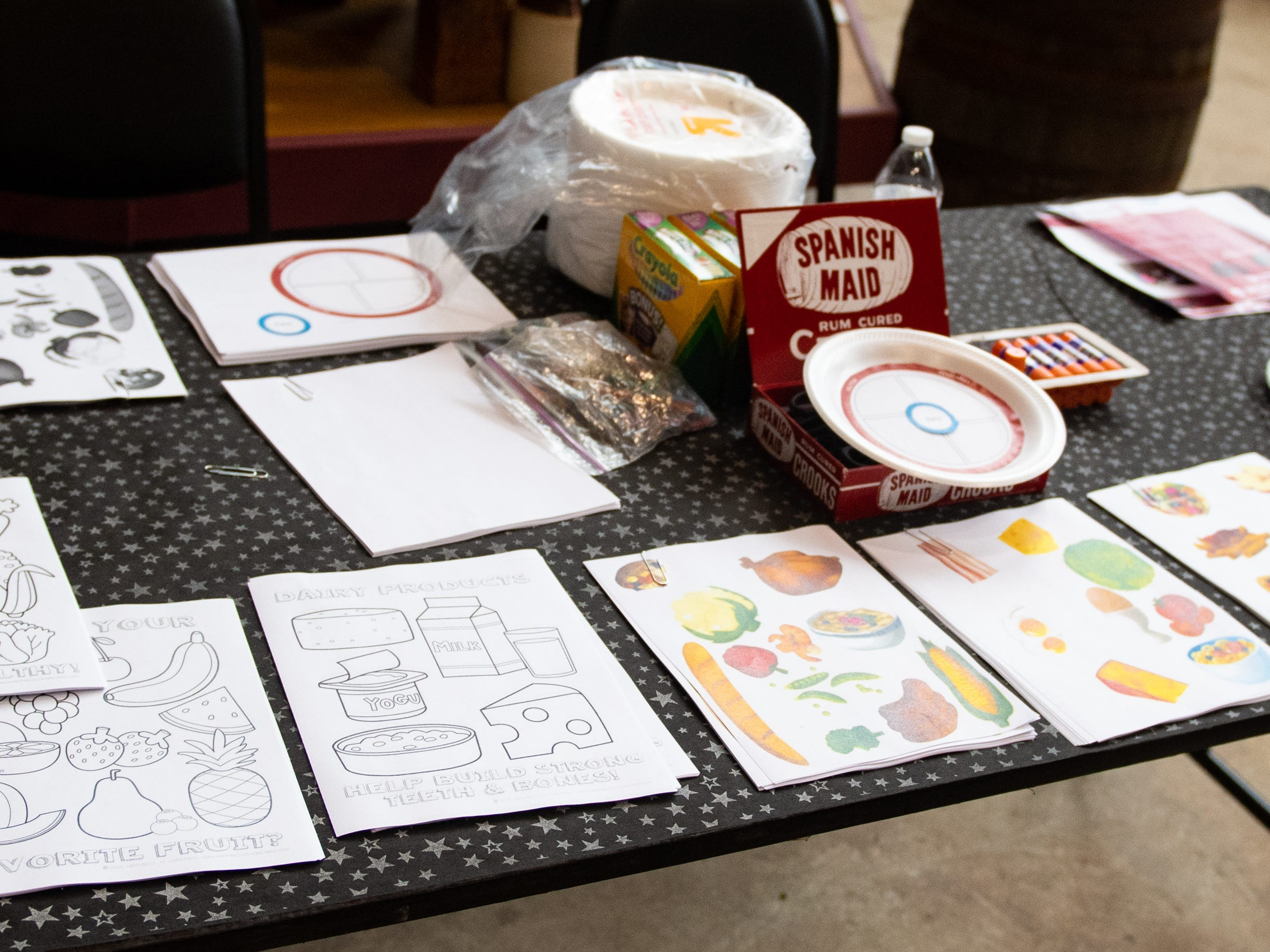 This booth allows children to choose what they think makes up a healthy meal. Many young Yorkers struggled with the vegetables portion, Friday, December 28, 2018.