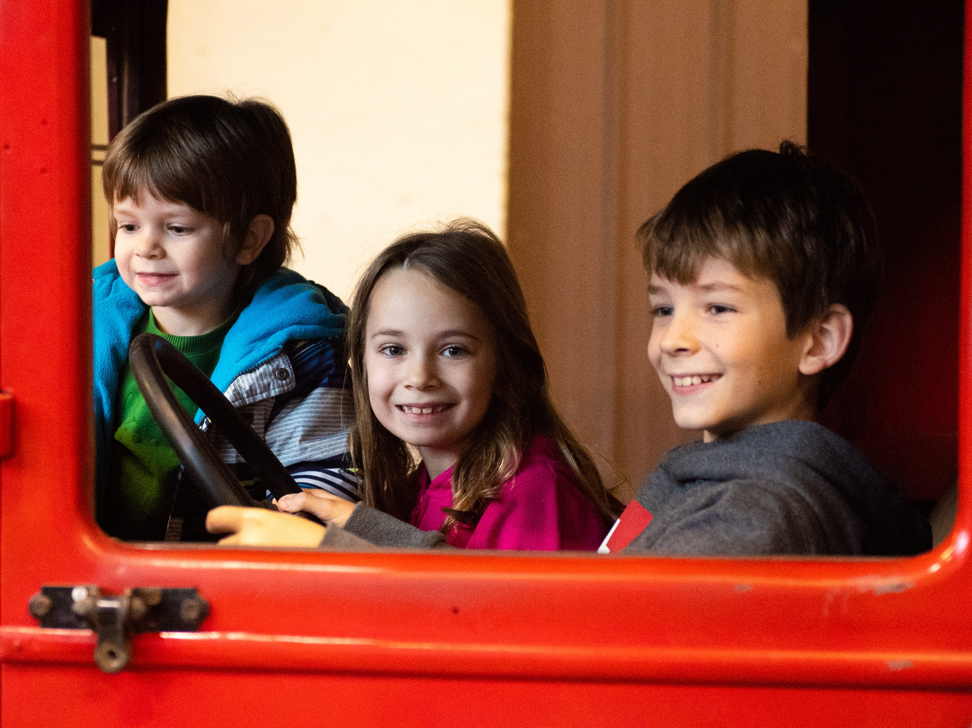 (Left to right) Garon, 4, Ada, 6, and Vonn Erdenbrack, 9, of Springettsbury Township sit in an old car during family activity day at the Agricultural and Industrial Museum, Friday, December 28, 2018.