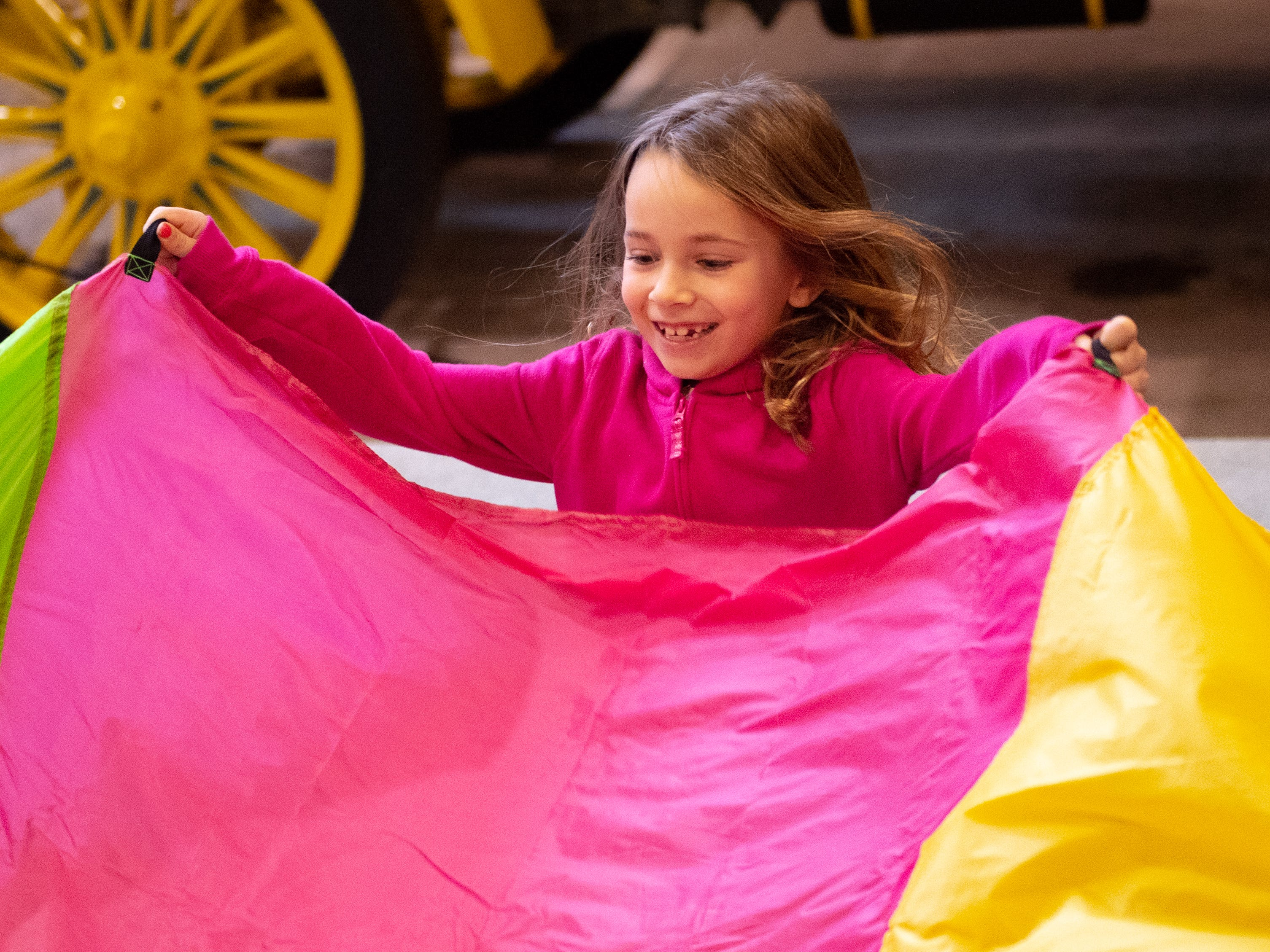 Ada Erdenbrack, 6, from Springrettsbury Township enjoys learning parachute games during Family Activity Day at the Agricultural and Industrial Museum, Friday, December 28, 2018.