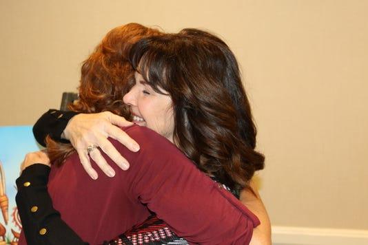 Janis Drexler Face On Camera Hugging Nancy Ponte