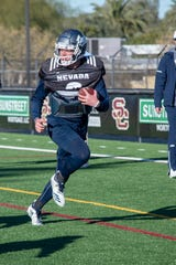 Wolf Pack quarterback Ty Gangi practices with the team on Friday.