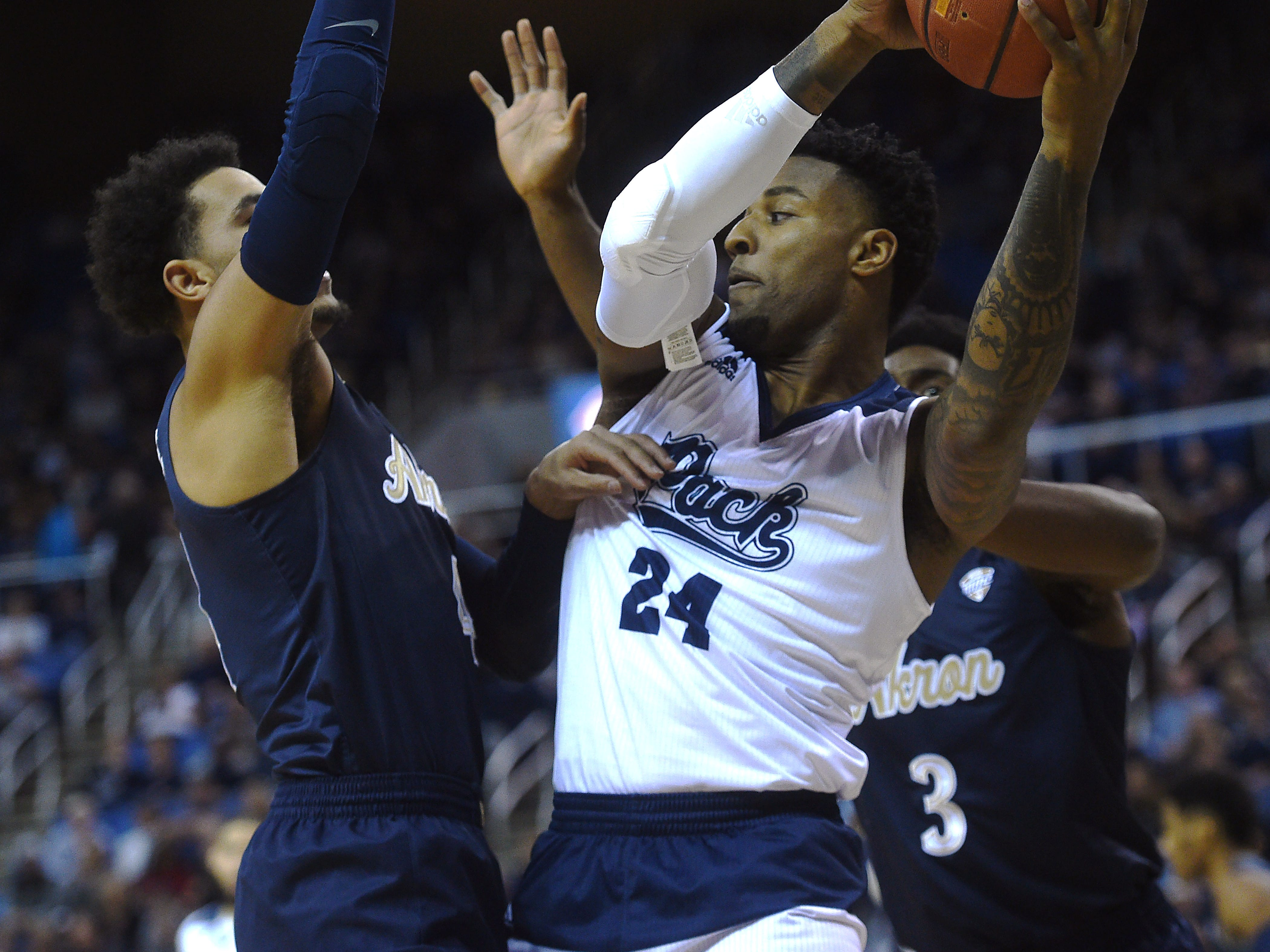 Nevada's Jordan Caroline (24) grabs a rebound while taking on Akron during their basketball game at Lawlor Events Center in Reno on Dec. 22, 2018.