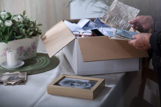 Packing Remembrances After Dead Husband