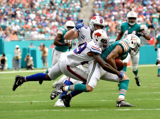 Buffalo Bills defensive back Siran Neal (29) tackles Miami Dolphins wide receiver Kenny Stills (10).