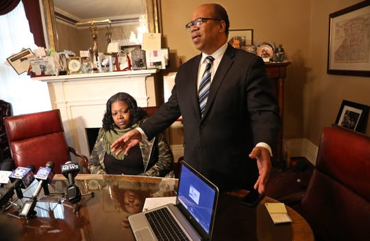 Attorney Van White plays a video tape showing the assault on Lucrecia Maddox's son by the Rochester Police Department at a press conference with her Friday Dec. 28, 2018 at White's Rochester office.