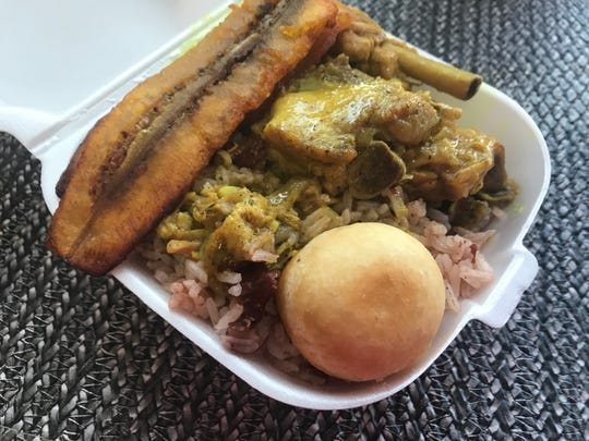 A small order of curry chicken at Kareen's Jamaican Kuisine comes with rice and beans, plantains and a dumplin.