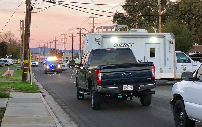 Police investigate the scene of a shooting that took the life of Newman police Cpl. Ronil Singh, 33, on Wednesday, Dec. 26, 2018, in Newman, Calif. Authorities were searching for a gunman who shot and killed the police officer during a traffic stop in California.