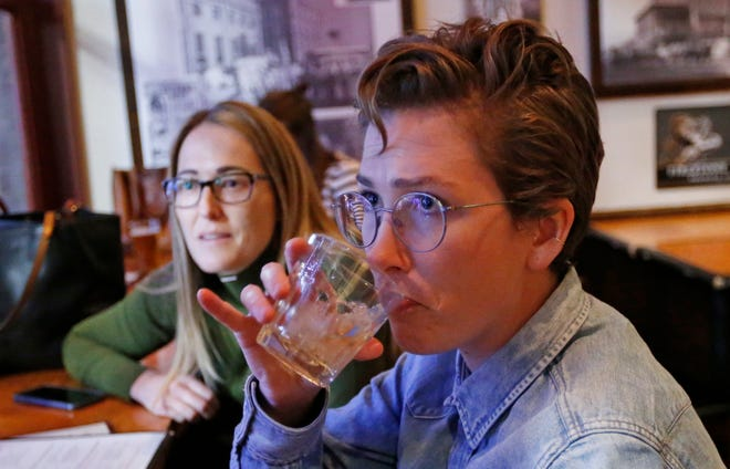 "Maude Romney, 29, right, drinks at the Beer Hive Pub in Salt Lake City. The United States' lowest DUI threshold took effect Dec. 30, 2018, in Utah. Romney said she'll likely only go to places she can walk to from her home downtown. ""I'm paranoid about it already,"" she said."