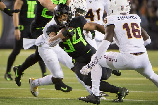 Nov 17, 2018; Eugene, OR, USA; Oregon Ducks running back CJ Verdell (34) picks up a first down during the second half against the Arizona State Sun Devils at Autzen Stadium. The Ducks beat the Sun Devils 31-29. Mandatory Credit: Troy Wayrynen-USA TODAY Sports