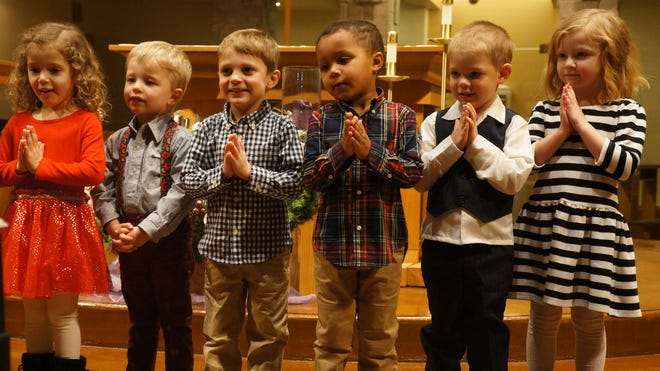 """Isabel Rupligner, Jack Doheny, Miles Wilke, Tre Blye, Blake Gade and Celia Ottery, all preschool students at Shepherd of the Hills Catholic School, sing """"Go Tell It On The Mountain"""" during their Christmas concert last week."""