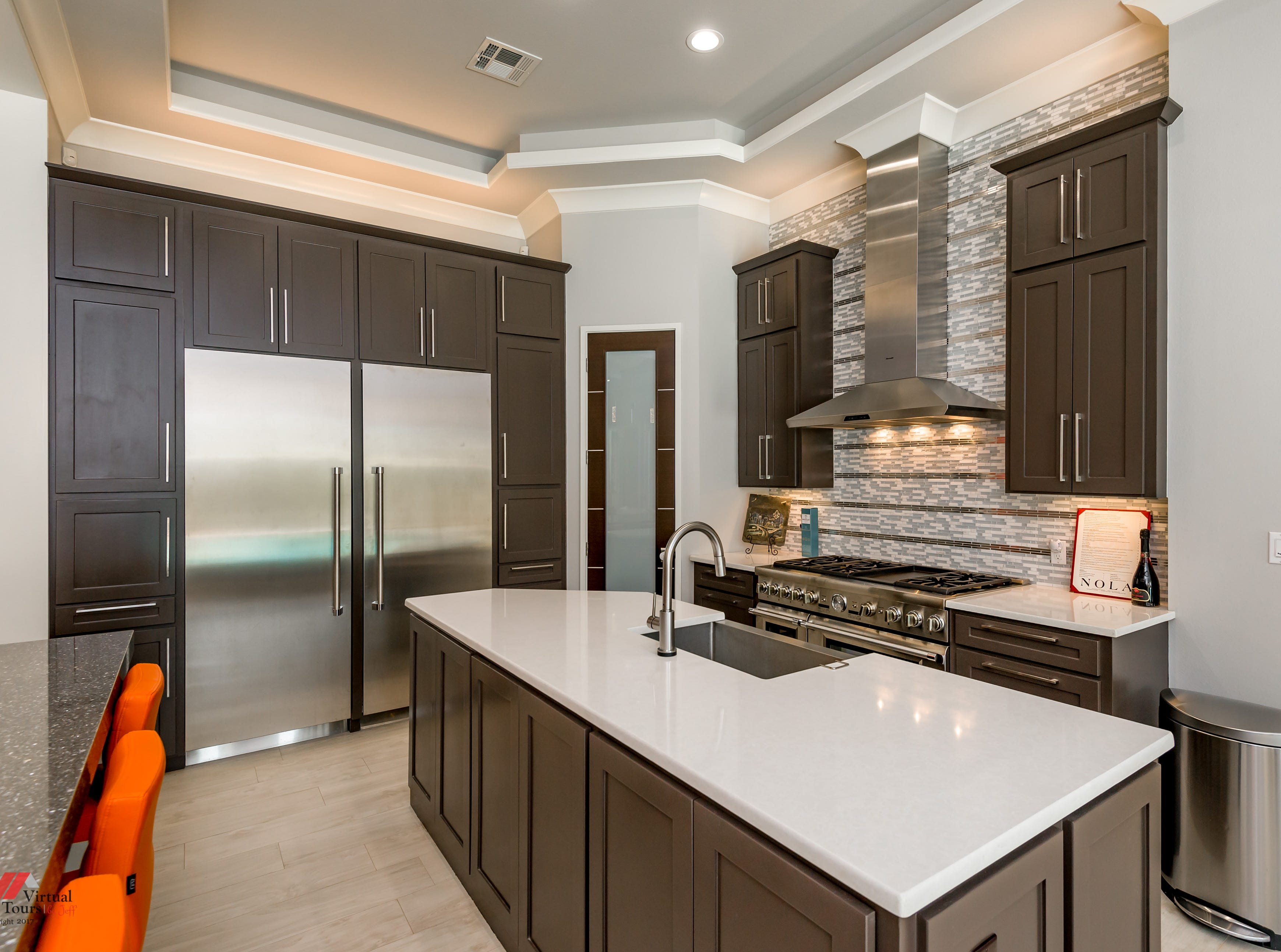 The ultra-modern kitchen features sleek design and special lighting touches.