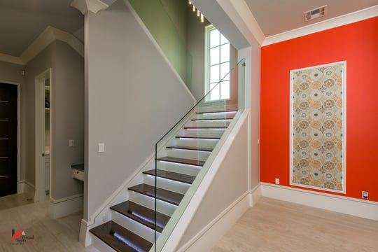 Touch sensitive lighting on the stairs light up with each step.