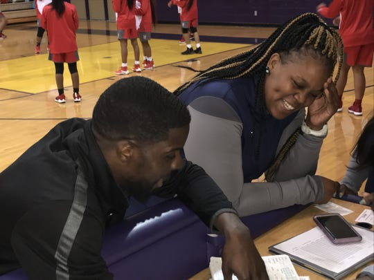 "North Caddo coach Brian Shyne and Huntington coach Danielle Butler share a laugh prior to their teams tipping off against each other in the 2018 ""Doc"" Edwards Invitational."