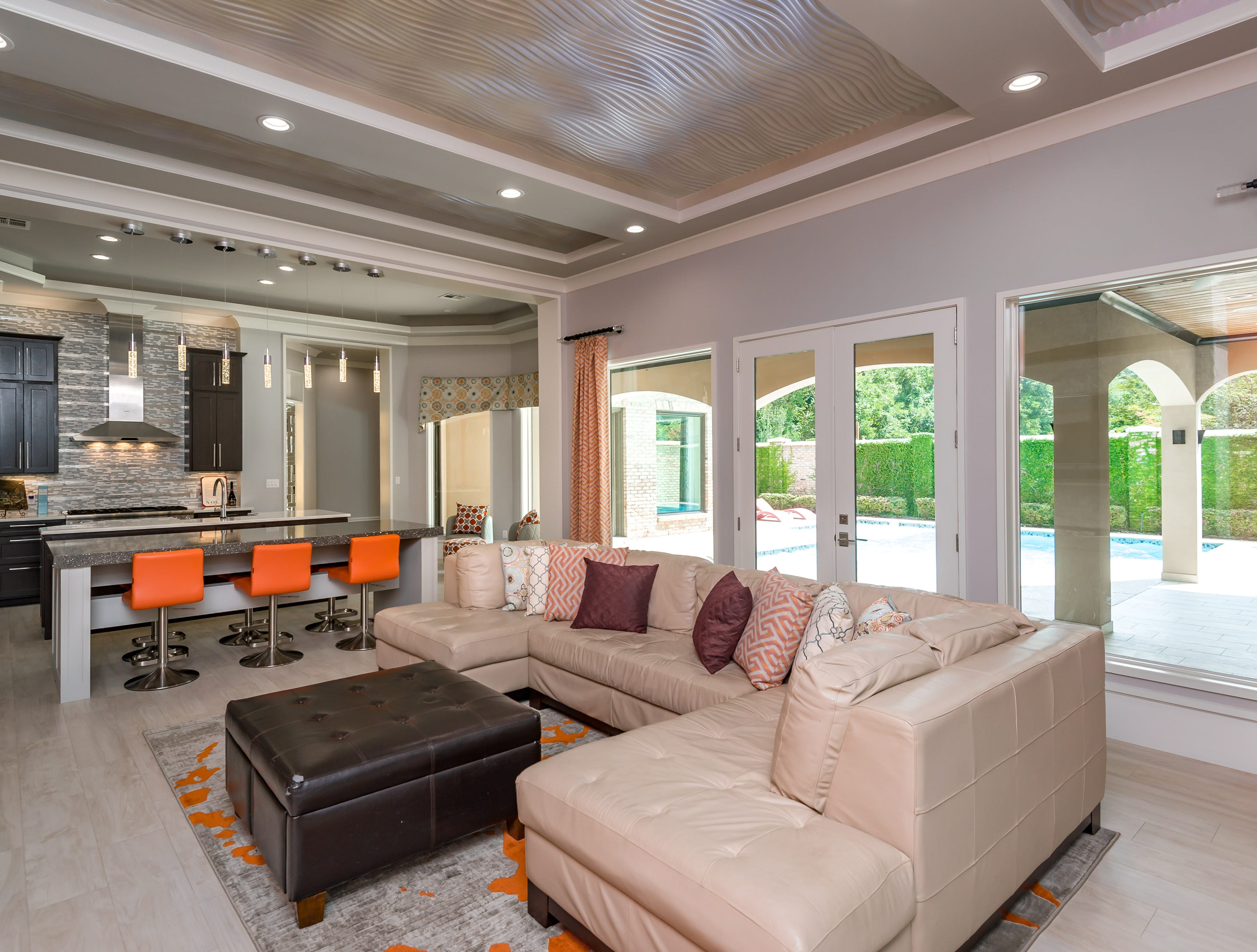 A wall of windows showcases the backyard oasis, and entertaining is made easy with the open concept.