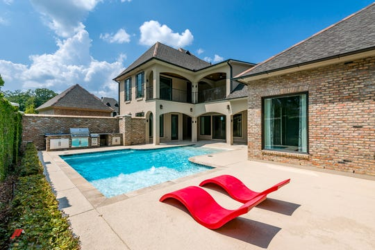 An outdoor grilling area and a beach entrance pool is made for entertaining.