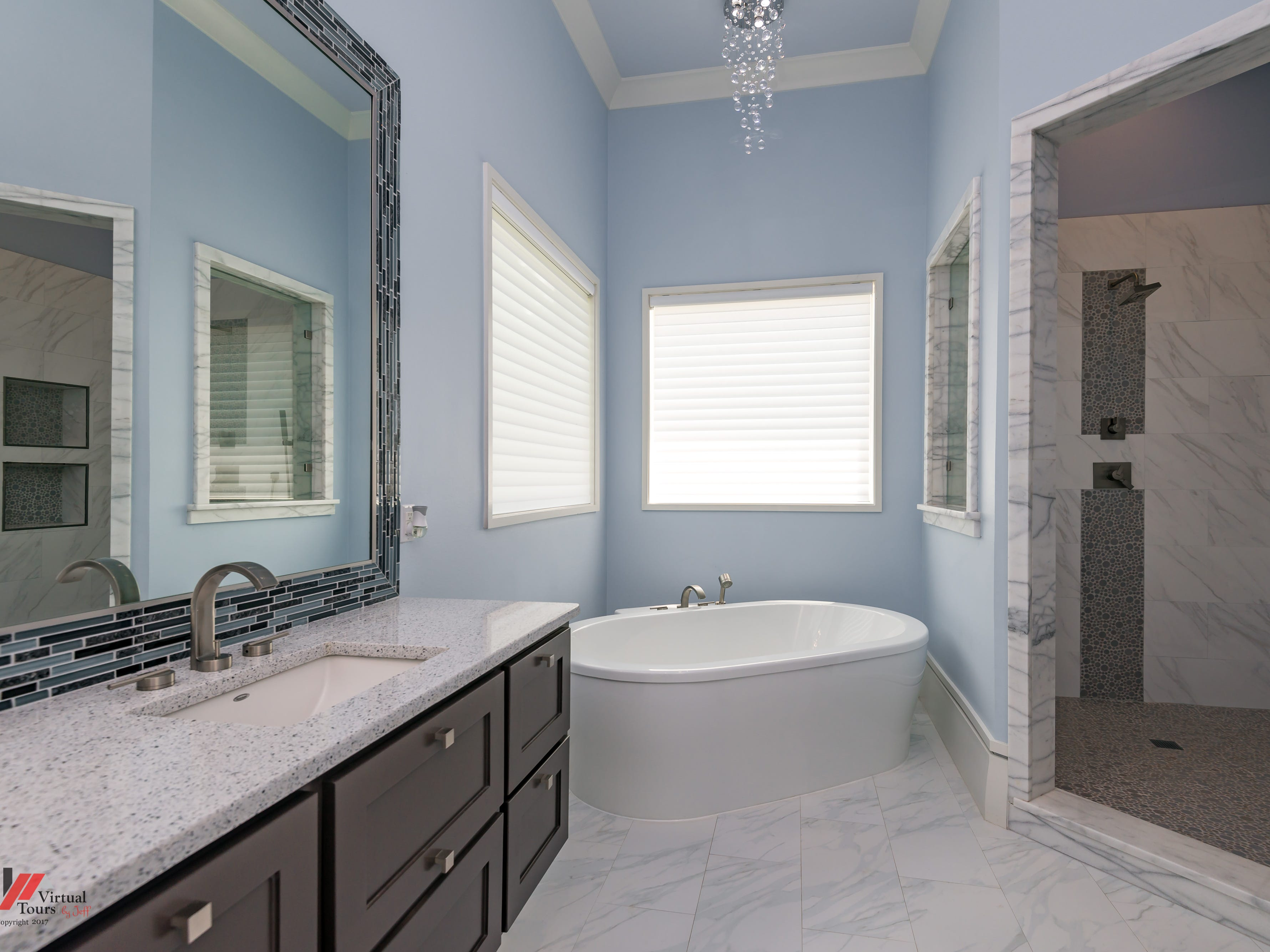 A soaking tub and spa-like shower is perfect to unwind in.