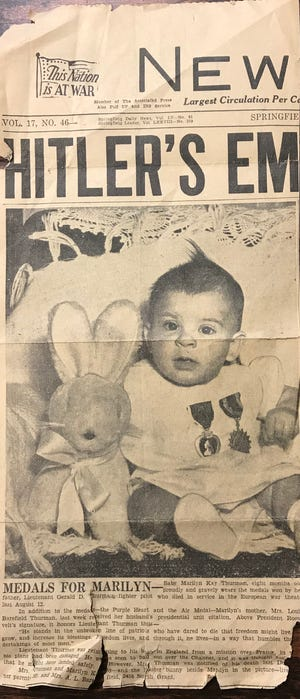 A photo of Marilyn Kay Thurman, only 8 months old, ran on the front page of this newspaper on April 1, 1945. She was photographed with the medals awarded to her father posthumously. Lt. Gerald D. Thurman, a fighter pilot, was shot down and killed during World War II. His plane went down into the English Channel.