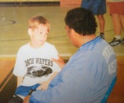 Five-year-old Matthew Farrar, left, talks with then-Fort Defiance wrestling coach Terry Waters during one of the coach's camps in this 2005 photo. Farrar is now a senior cadet at Fishburne Military School in Waynesboro, Va., and Waters became the Caissons' coach in 2015, the same year Farrar transferred to Fishburne.