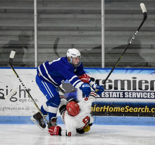Monticello and Sartell players collide along the boards Friday, Dec. 28, during the Granite City Hockey Showcase at the MAC in St. Cloud.