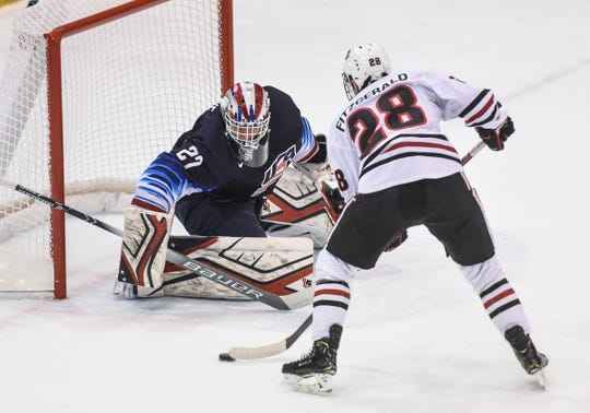 St. Cloud State's Kevin Fitzgerald takes a shot on goaltender Cameron Rowe during the Thursday, Dec. 27, game against the U.S. National Under-18 team at the Herb Brooks National Hockey Center in St. Cloud.
