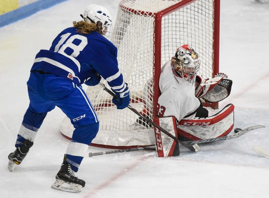 Sartell's Jack Hennemann takes a shot on Monticello goaltender Nash WIlson Friday, Dec. 28, during the Granite City Hockey Showcase at the MAC in St. Cloud.