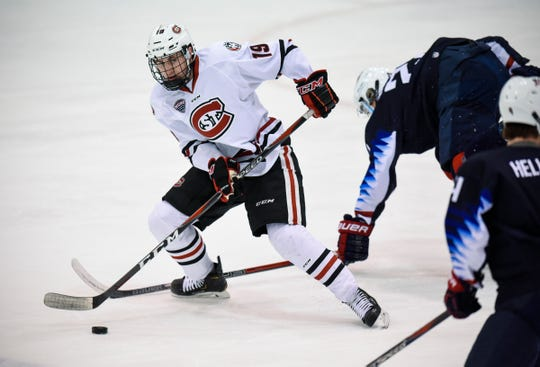 Sam Hentges skates with the puck during the Thursday, Dec. 27, game against the U.S. National Under-18 team at the Herb Brooks National Hockey Center in St. Cloud.