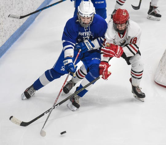 Troy Dahlheimer of Monticello and Ryan Zulkosky of Sartell struggle for control of the puck Friday, Dec. 28, during the Granite City Hockey Showcase at the MAC in St. Cloud.