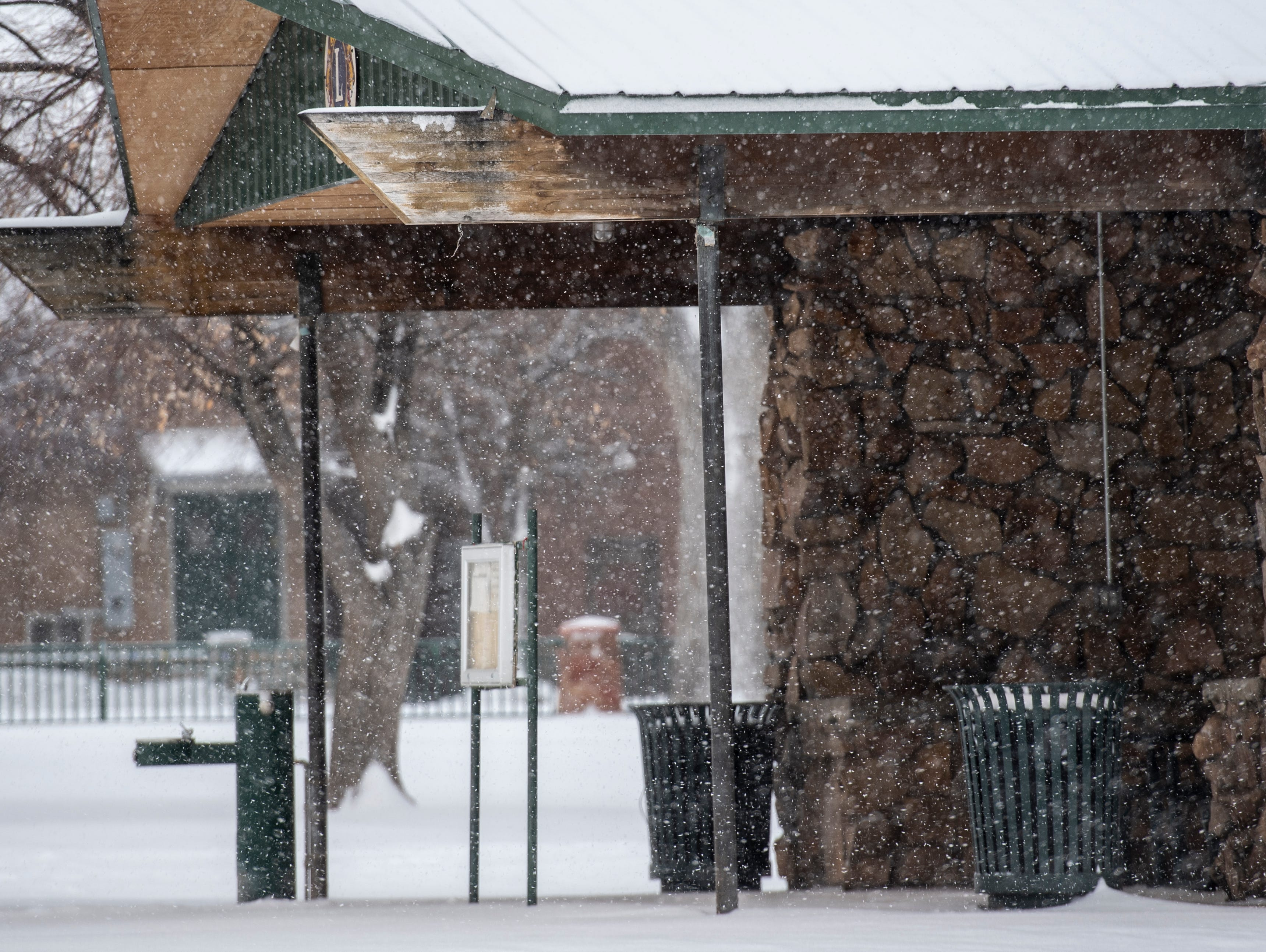 Snow falls on downtown Cedar City Friday, December 28, 2018.