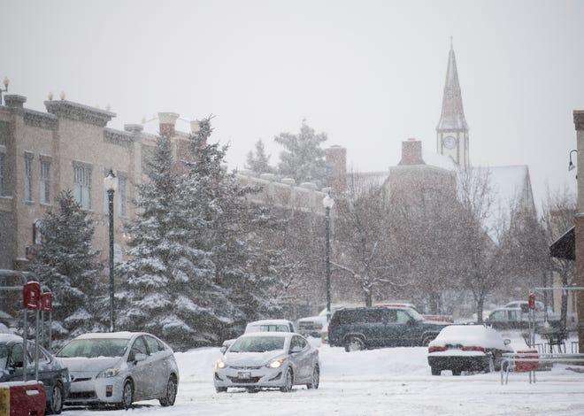 Snow falls on downtown Cedar City Friday, December 28, 2018.