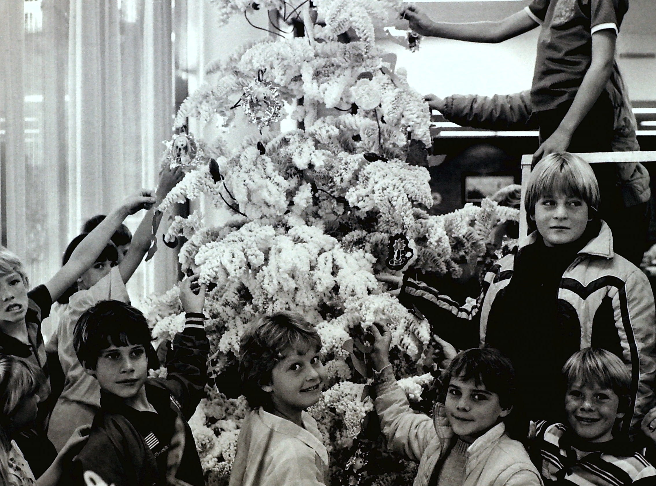 West Elementary students decorate the Zion Bank Christmas Tree circa 1985.