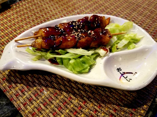 Yaki Tori, grilled chicken on a stick slathered with a sweetened soy sauce, at Fujiyama's Japanese Steakhouse & Sushi Lounge.