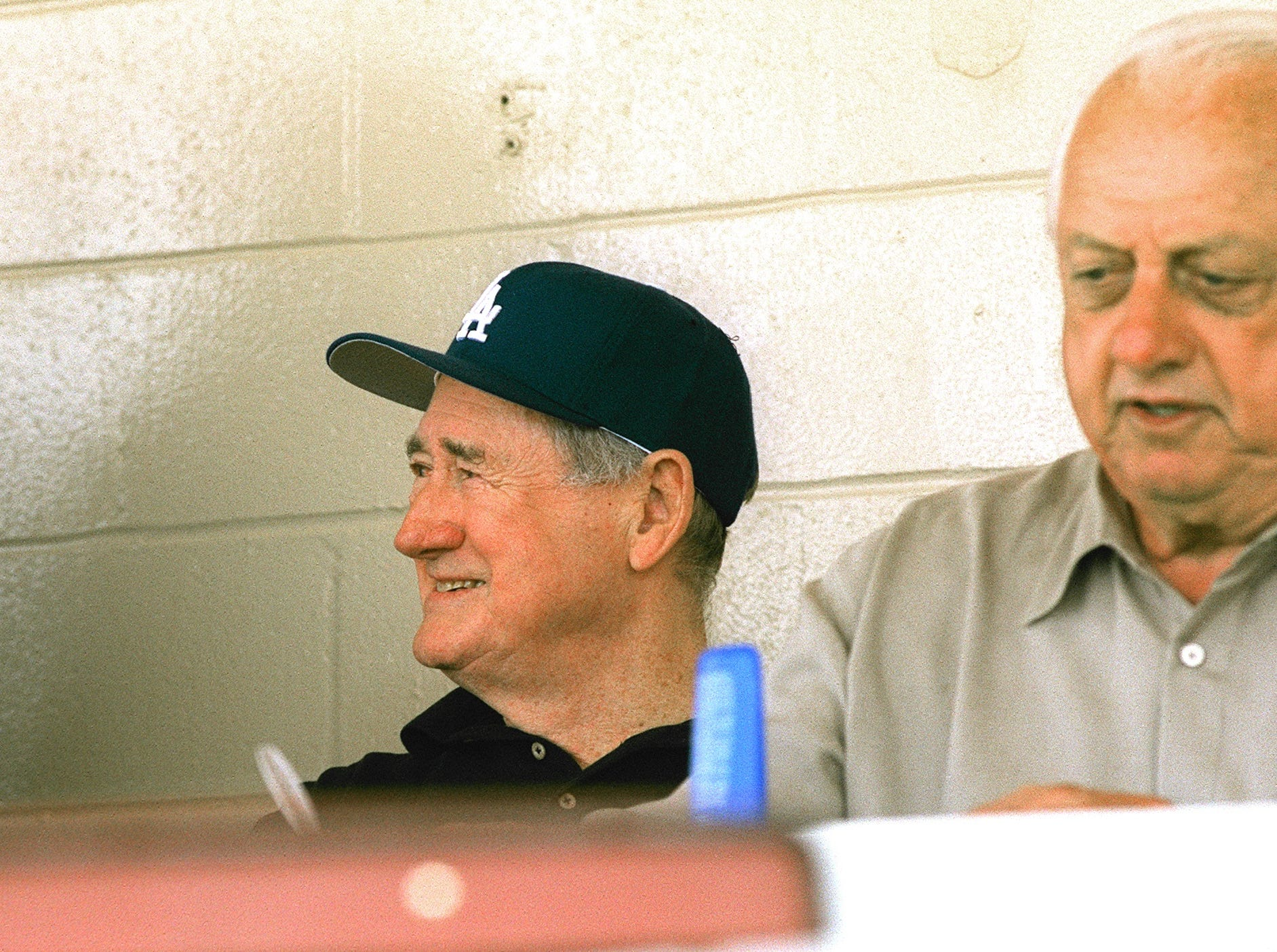 Elden Auker (from left), Ted Williams  and Tommy Lasorda sit in the press box during a spring training game between the Los Angeles Dodgers and the Houston Astros in March 2000 at Holman Stadium.