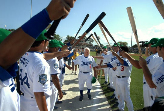 Tommy Lasorda, center, former manager of the L.A. Dodgers current Special Advisor to the Chairman, walks out of Holman Stadium at Dodgertown, March 17, 2008, after the Dodgers 12-10 loss to the Houston Astros. The game was the last game played by the Dodgers at the stadium where they trained for 60 years.