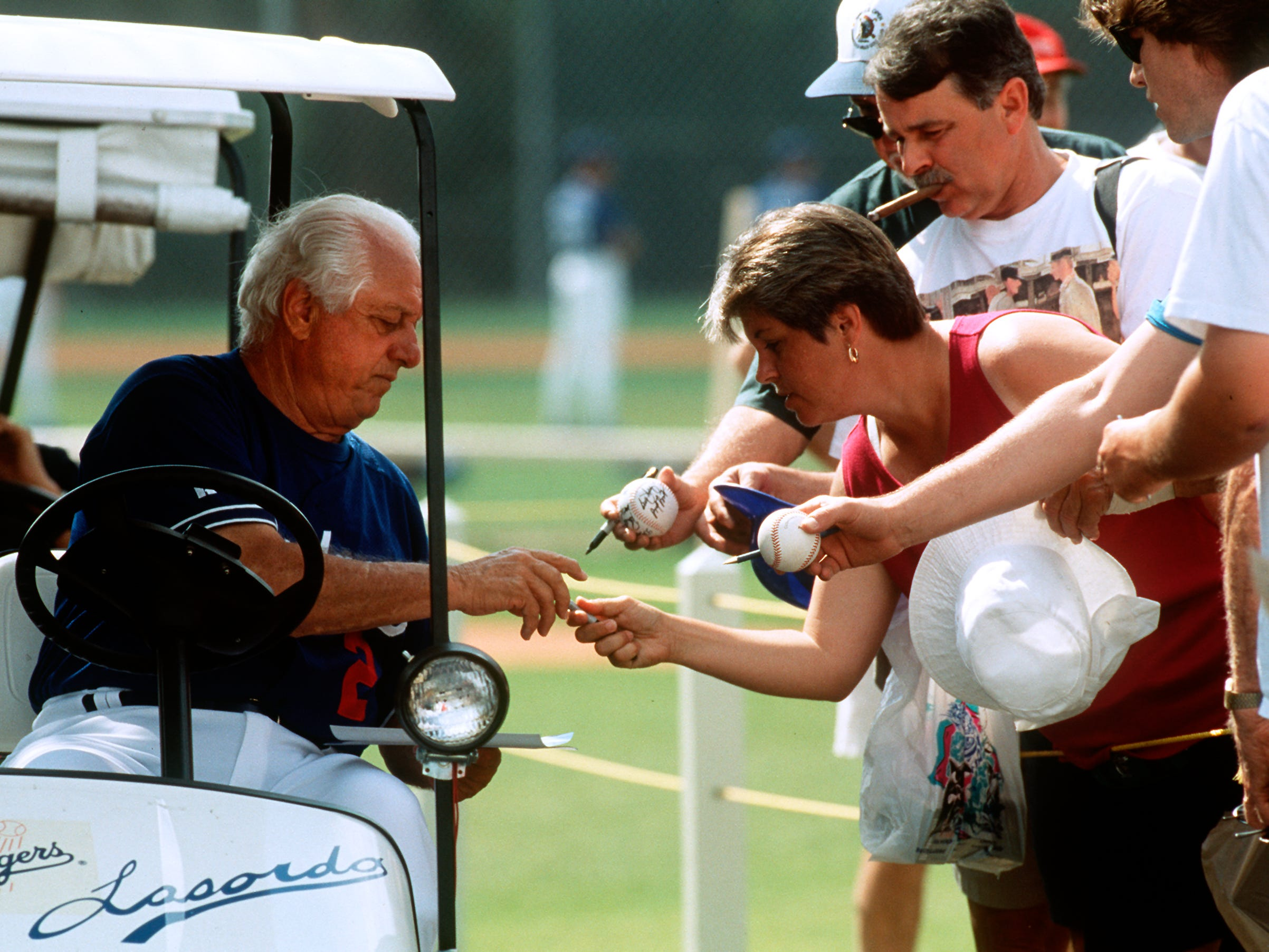 Dodgers manager Tommy Lasorda signs autographs during spring training in Vero Beach at Dodgertown in March 1996.