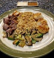Fujiyama Japanese Steakhouse & Sushi Lounge's platter of scallops and filet mignon.
