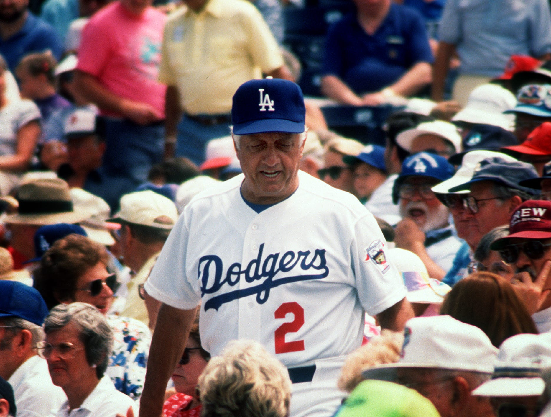 Los Angeles Dodgers manager Tommy Lasorda walks through the stands in Holman Stadium at Dodgertown before the start of the last spring training game of the season in April 1992.