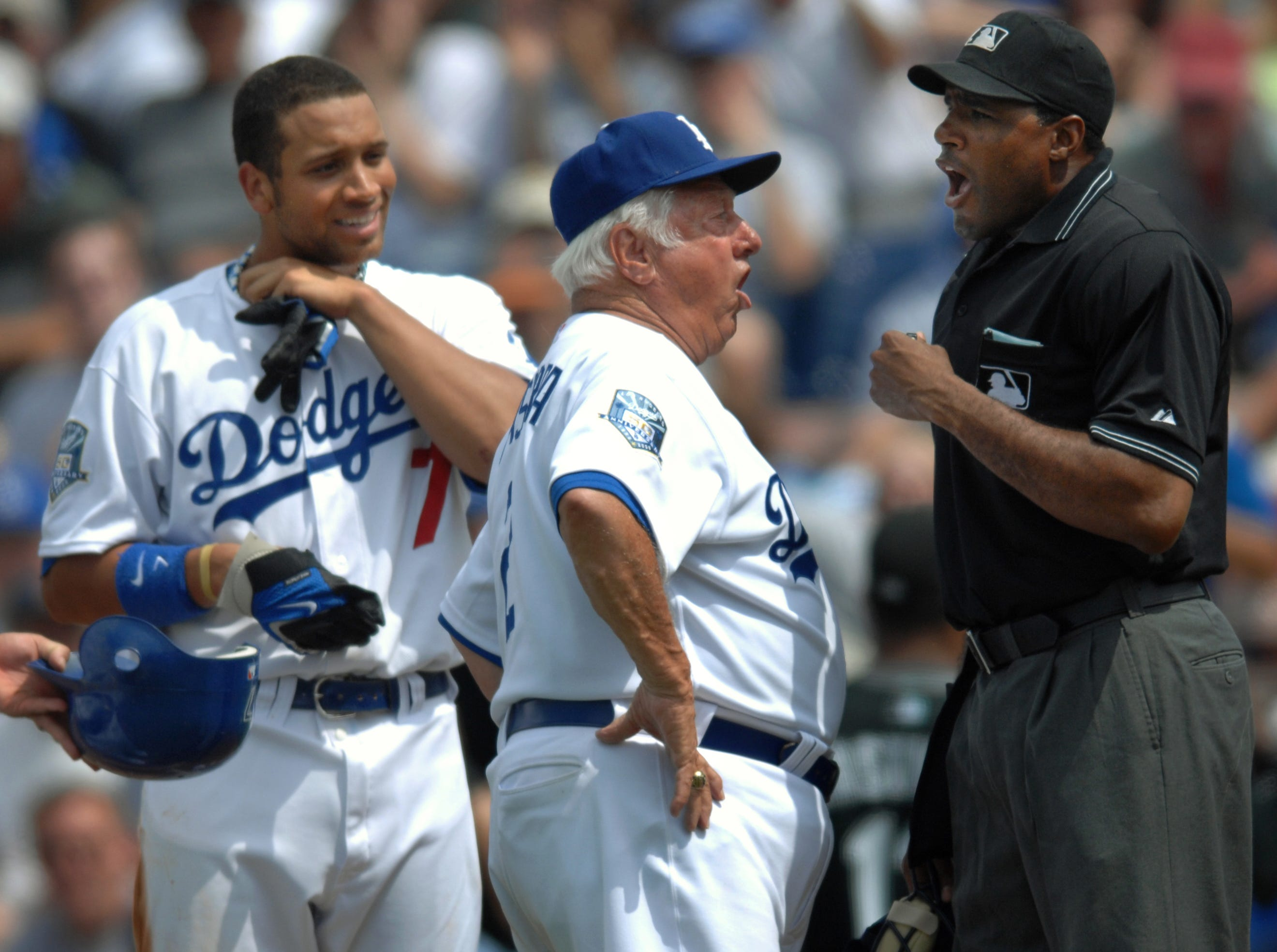 Former L.A. Dodgers manager Tommy Lasorda, second from right, argues a call with umpire Damien Beal March 11, 2008, after Beal called James Loney out (left) after being tagged on his way to first base. Lasorda believed the ball had rolled foul before being picked up by Florida Marlins Pitcher Andrew Miller. The Marlins defeated the Dodgers, 7-6.