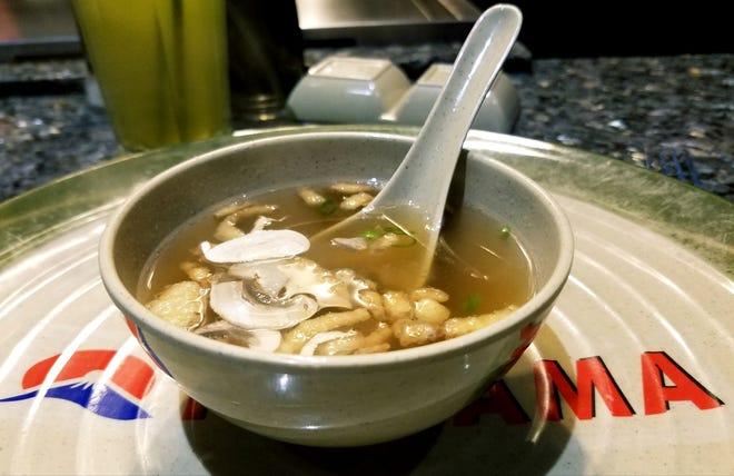 Fujiyama's hot miso soup garnished with sliced mushrooms and crispy onions.