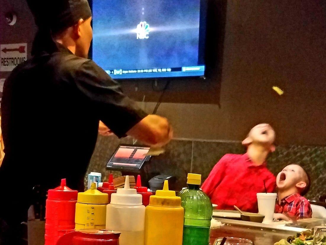 Fujiyama chef tosses egg at customers.