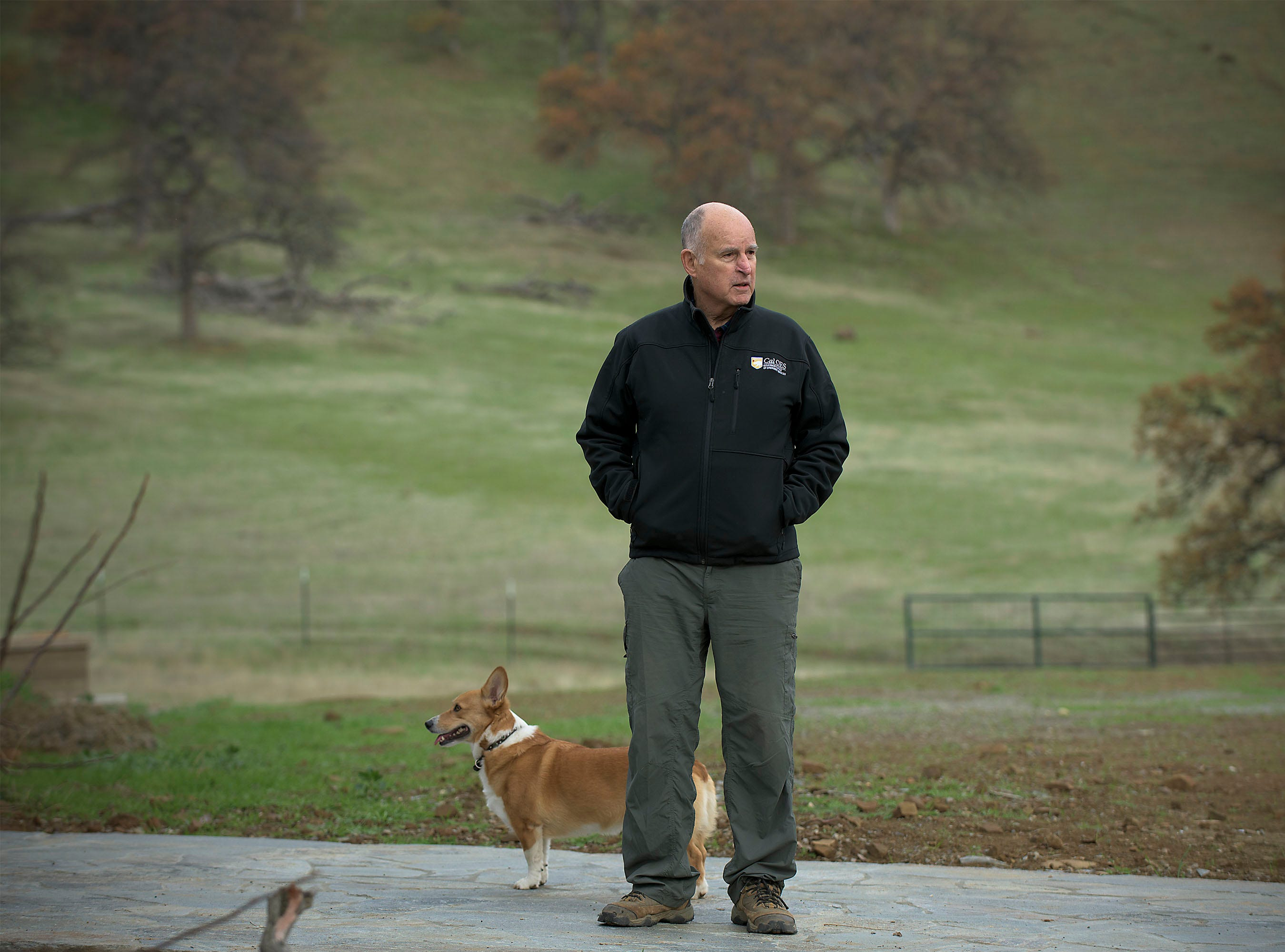 California Gov. Jerry Brown spends time with his dog, Colusa, at his ranch home near Williams. Brown leaves office Jan. 7 after a record 16 years as governor.