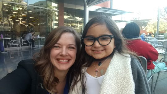 Emily Barany of Ventura poses with Eliana Georges, an 8-year-old coronary patient. Barany helped set up an airlift to get patients to their essential treatments after Highway 101 was blocked in the Montecito Mudslides of early 2018. Eliana was transported by helicopter from Santa Barbara to Children's Hospital in Los Angeles.